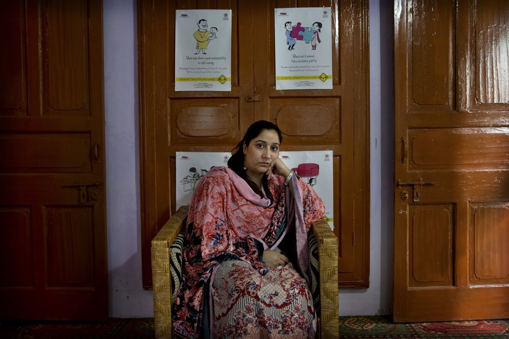 "Mantasha Binti Rashid, founder of Kashmir Women's Collective, sits for a photograph in Srinagar. Since the lockdown, her organisation has seen a marked rise in violence against women as victims do not have a way to reach out for help. She cites examples: a woman attacked and brought to a hospital 90% covered with burns, many beaten by husbands or thrown out of their homes, another who faced abandonment. ""Women suffer disproportionately,"" she said. ─ AP"