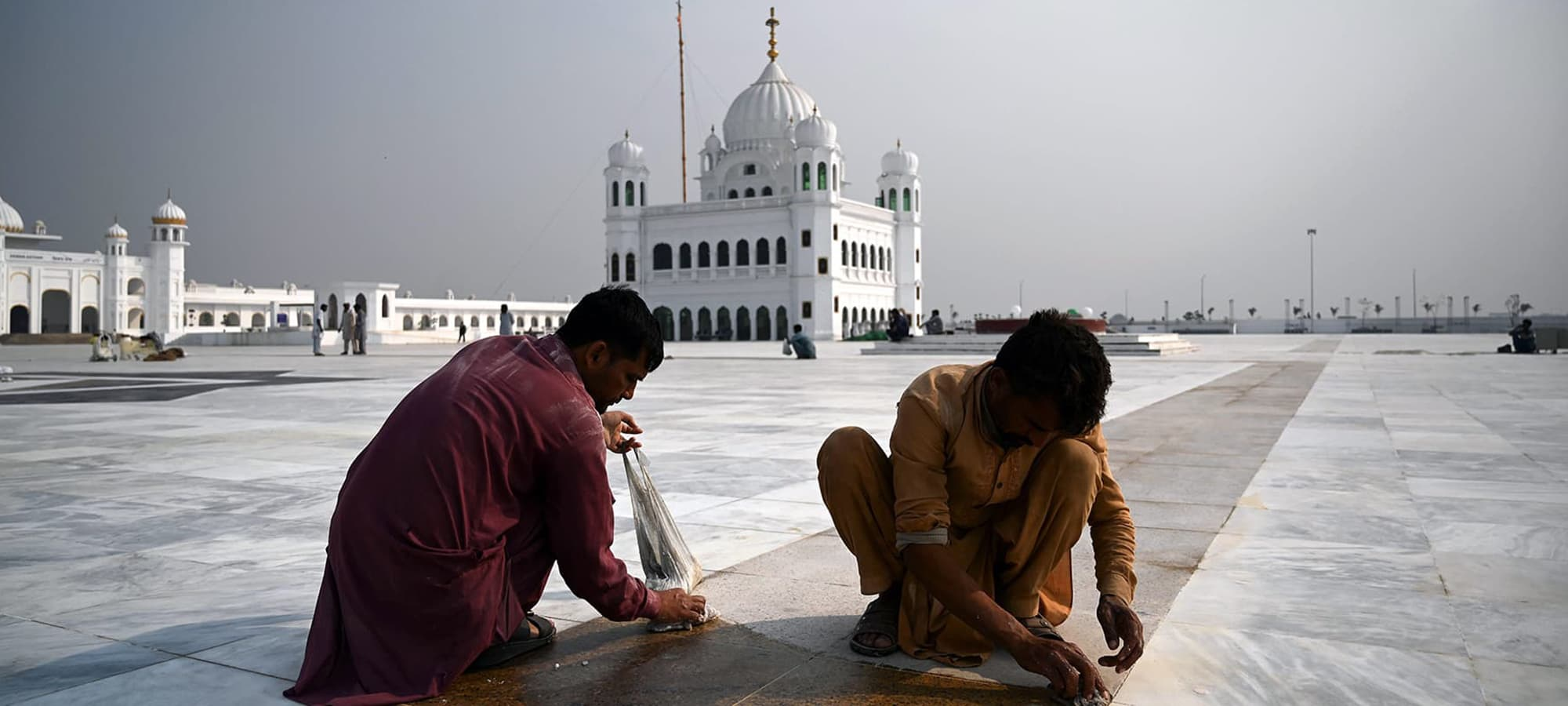 In this picture taken on November 6, 2019 workers shine a floor at the Shrine of Baba Guru Nanak Dev at the Gurdwara Darbar Sahib ahead of its opening, in the Pakistani town of Kartarpur near the Indian border. - Thousands of Sikh pilgrims are expected around the world to visit to Pakistan to celebrate the 550th birth anniversary of Sri Guru Nanak Dev which falls on November 12. (Photo by Aamir QURESHI / AFP) — AFP or licensors
