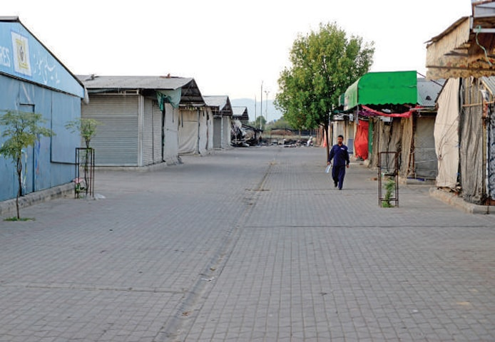 The weekly bazaar in H-9 gives a deserted look on Friday. Residents of the twin cities have been suffering since the weekly bazaars in H-9 and G-10 were closed after the Azadi March participants camped near Peshawar Mor. — White Star