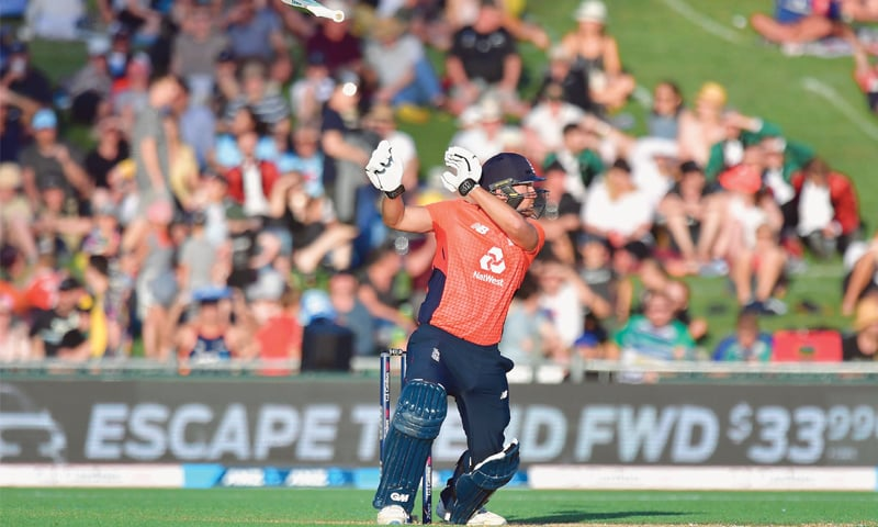 ENGLAND'S century-maker Dawid Malan loses the bat as he plays a shot during the fourth Twenty20 International against New Zealand at McLean Park on Friday.—AFP