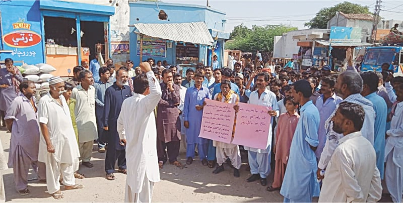 Nagarparkar residents hold a protest demonstration on Friday against unbridled extraction of granite from their area by unauthorised traders.—Dawn