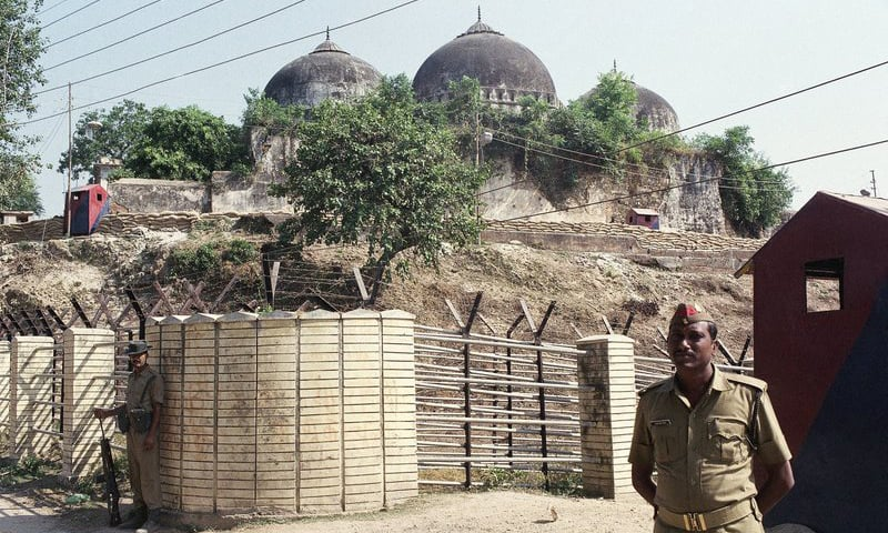 In this Oct 29, 1990, file photo, an Indian security officer guards the Babri Mosque in Ayodhya, closing off the disputed site claimed by Muslims and Hindus. — AP/File