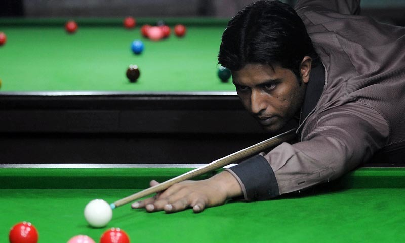 The 37-year-old Asif outplayed third seed Kritsanut Lertsattayathorn of Thailand 7-0 in best of 13 frames semi-final. — AFP/File In this photograph taken on September 13, 2013 Pakistani snooker player Mohammad Asif plays at a snooker club in Faisalabad.  Rising sports stars regularly spout the cliche about not letting success change them, but in the case of Mohammad Asif, Pakistan's sole current world champion, it seems to be true. The 31-year-old was given a hero's welcome when he returned to Pakistan after winning the amateur world snooker championship a year ago, feted by politicians and me