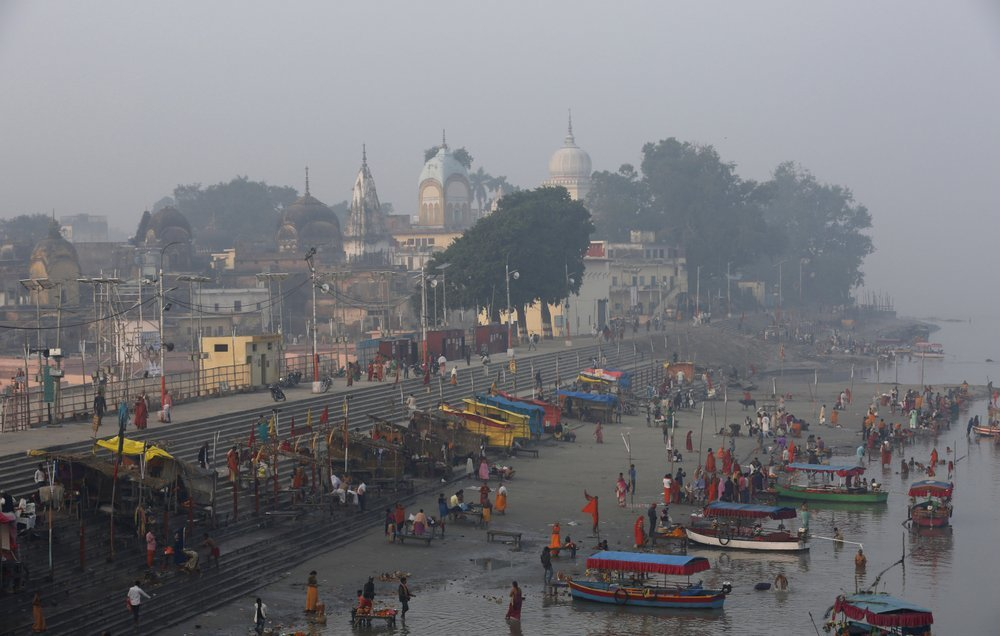 Hindu pilgrims gather by the banks of the River Sarayu to perform morning rituals in Ayodhya, India , Saturday, Nov. 9, 2019. India's security forces were on high alert ahead of the Supreme Court's verdict Saturday in a decades-old land title dispute between Muslims and Hindus over plans to build a Hindu temple on a site where Hindu hard-liners demolished a 16th century mosque in 1992, sparking deadly religious riots. (AP Photo/Rajesh Kumar Singh) — AP