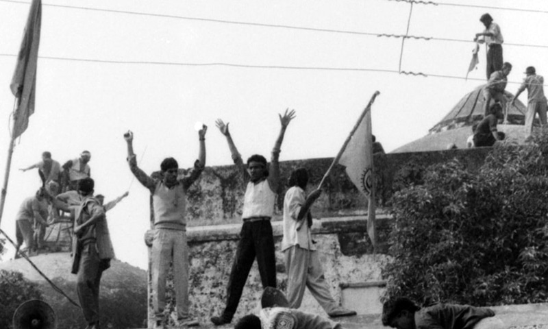 "What place for their leaders in ""one of the most important cases in the world""? Hindutva activists climb the dome of Babri Masjid in Ayodhya on December 6, 1992, and complete its demolition in hours as senior BJP leaders egged them on. — Archival photograph: Sondeep Shankar"