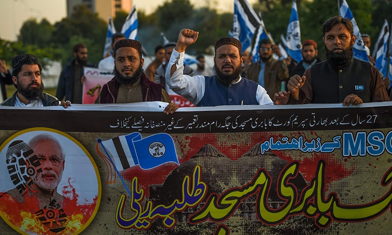 Students shout slogans in a protest against India's Supreme Court verdict about the disputed holy site awarded to Hindus, in Islamabad on Saturday. — AFP