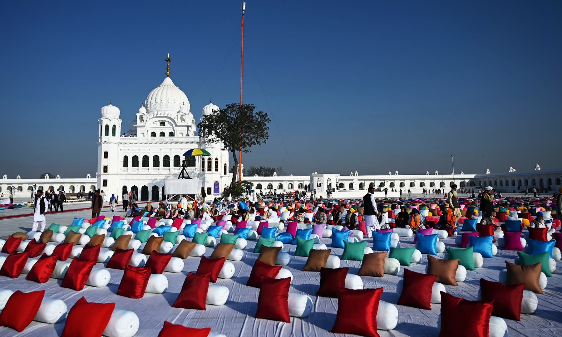Sitting places with pillows are set out for Sikh pilgrims to attend a ceremomy for the inauguration of the Shrine of Baba Guru Nanak Dev at Gurdwara Darbar Sahib in Kartarpur, Pakistan, on Saturday. — AFP