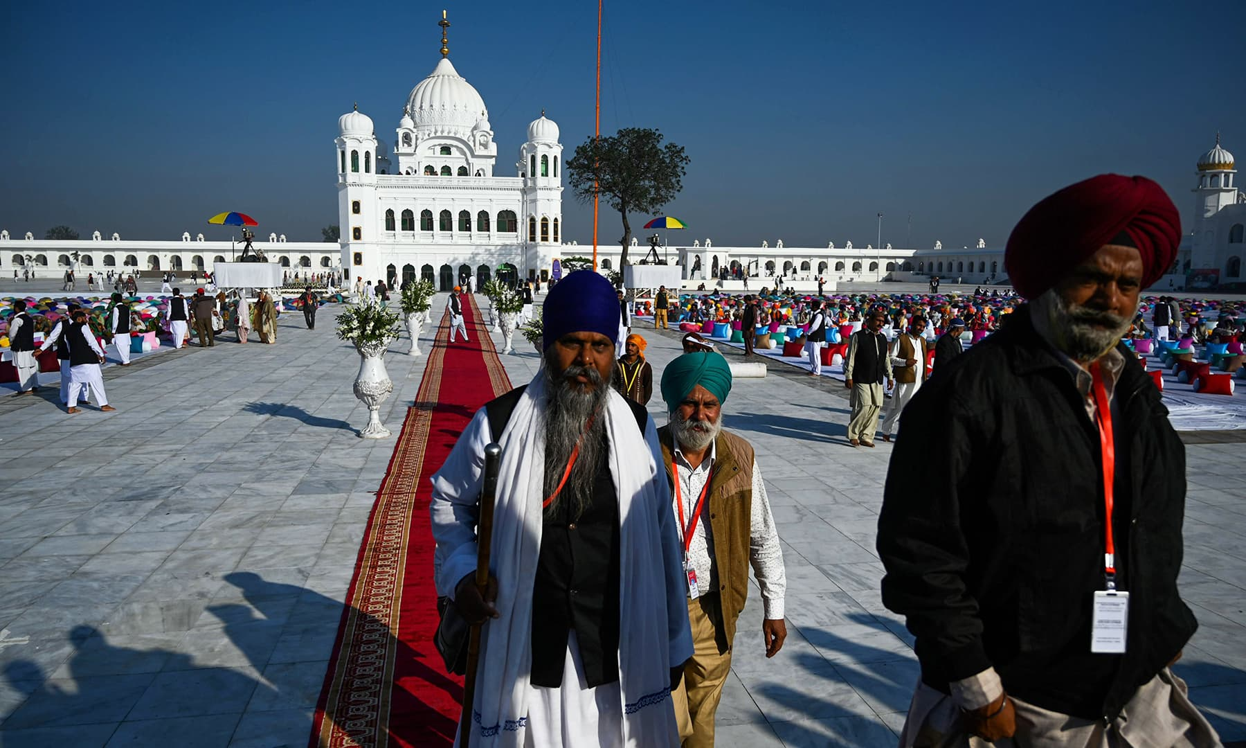 Sikh pilgrims arrive to visit the Shrine of Baba Guru Nanak Dev at Gurdwara Darbar Sahib in Kartarpur on Saturday. — AFP