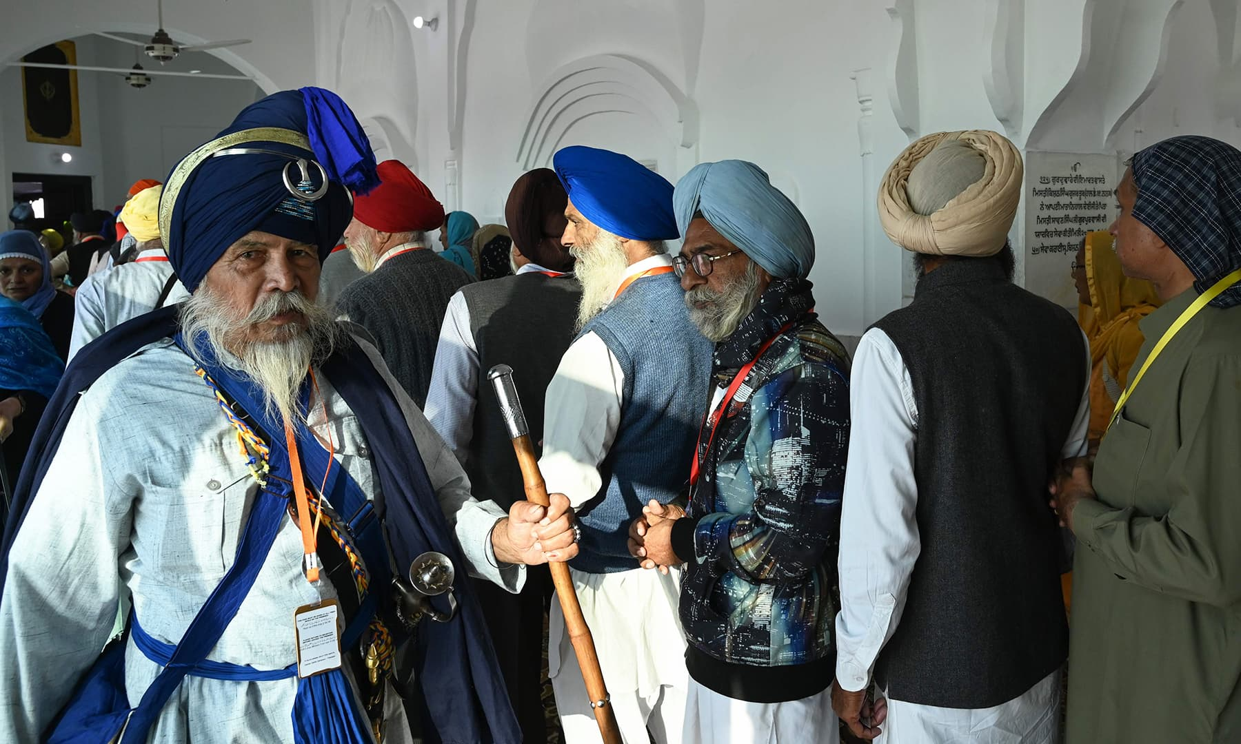Sikh pilgrims arrive through the corridor to visit the Shrine of Baba Guru Nanak Dev at Gurdwara Darbar Sahib in Kartarpur on Saturday. — AFP