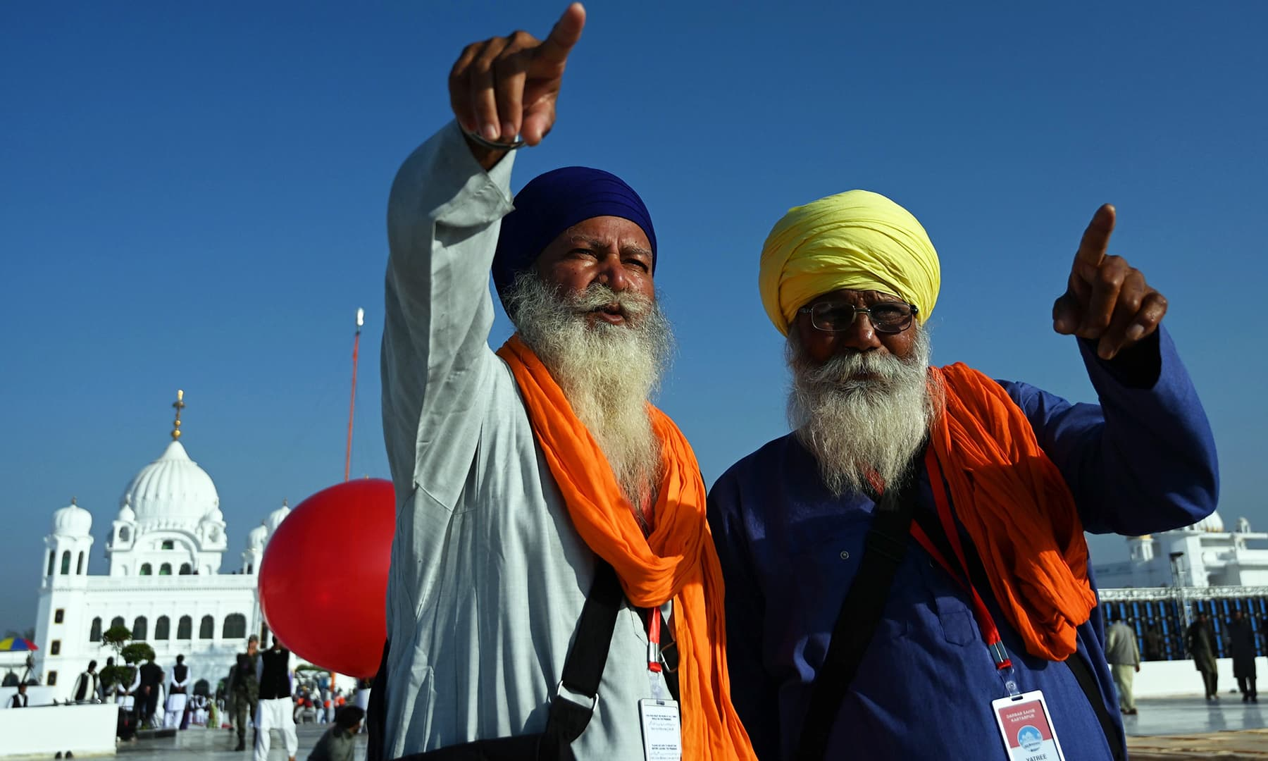 Sikh pilgrims point at the inauguration site of the Shrine of Baba Guru Nanak Dev at Gurdwara Darbar Sahib in Kartarpur on Saturday. — AFP