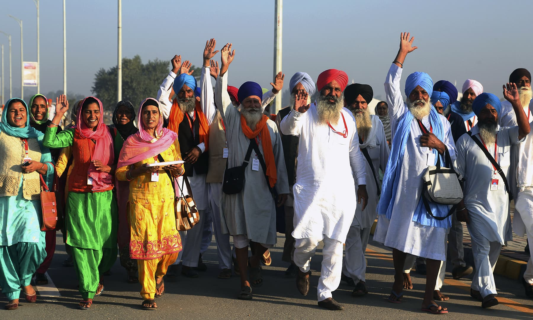 Sikh pilgrims arrive to visit the shrine of their spiritual leader Guru Nanak Dev, at Gurdwara Darbar Sahib in Kartarpur, Pakistan, on Saturday. — AP