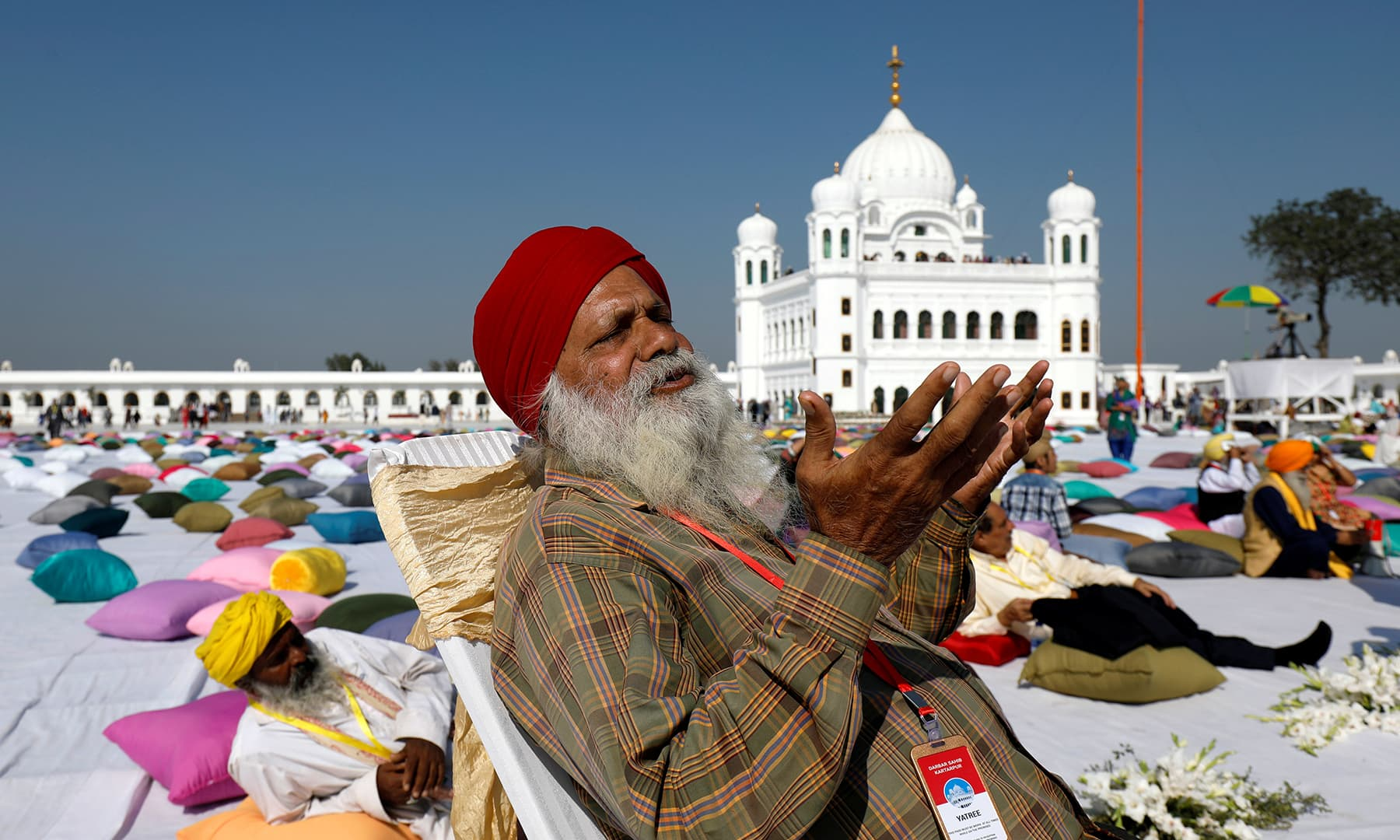 An Indian Sikh pilgrim offers prayers as he visits the Gurdwara Darbar Sahib in Kartarpur on Saturday. — Reuters
