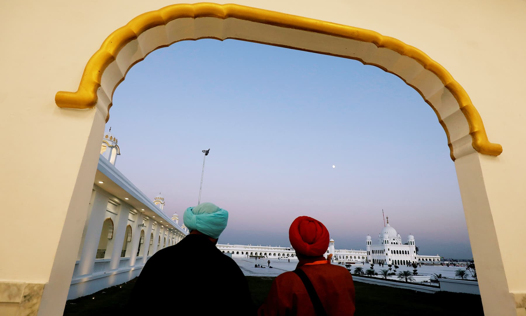 Indian Sikh pilgrims take in the view as they visit the Gurdwara Darbar Sahib in Kartarpur on Saturday. — Reuters