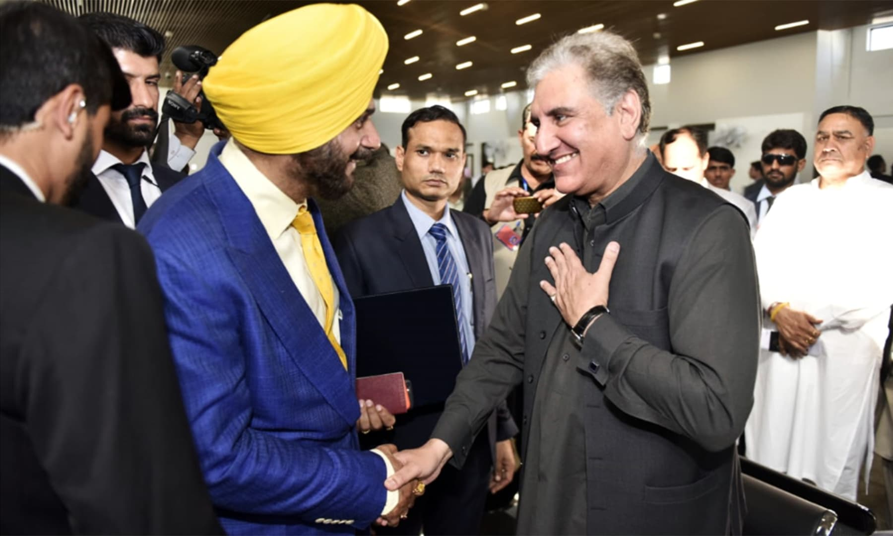 Foreign Minister Shah Mahmood Qureshi greets Navjot Singh Sidhu. — Foreign Office