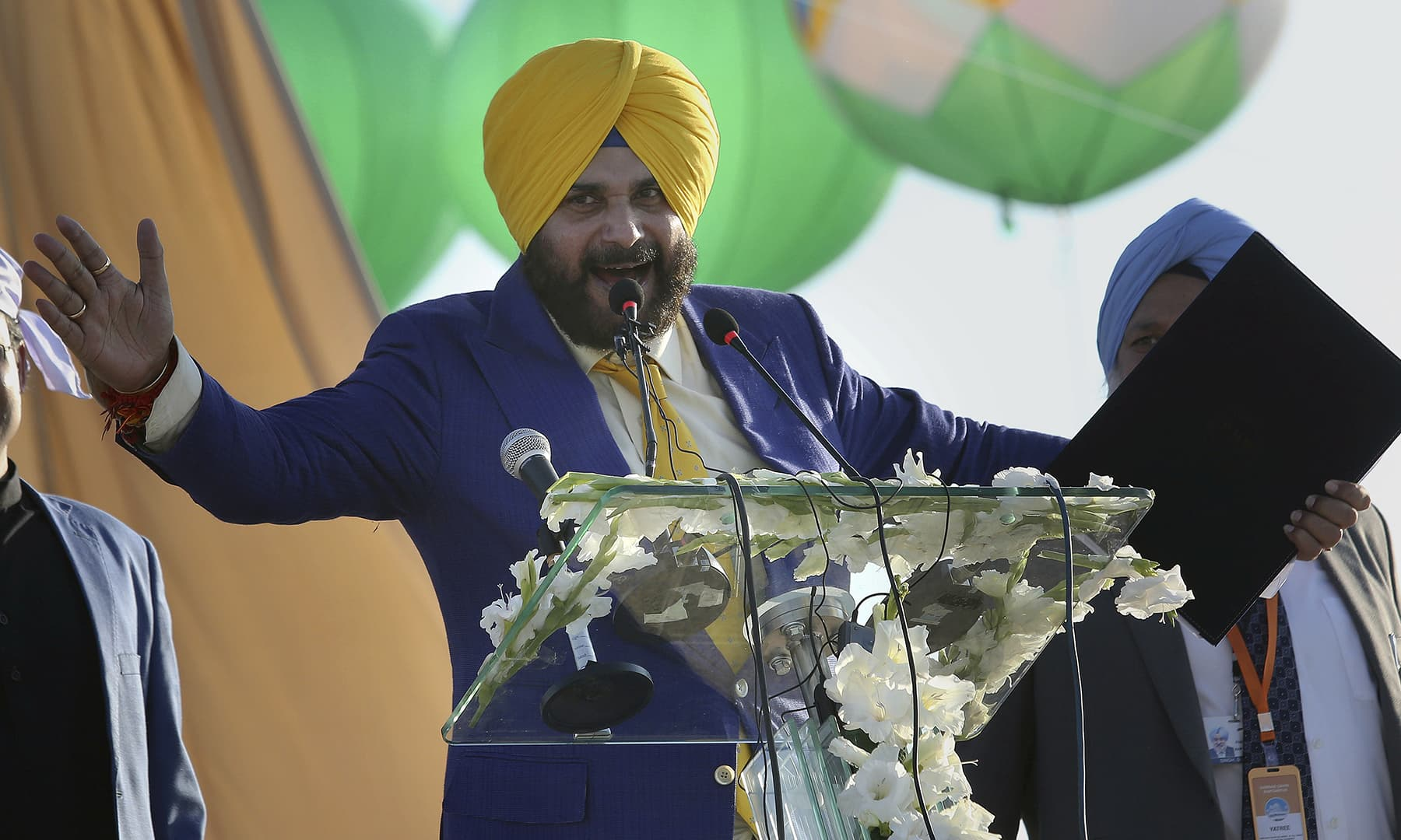 Indian cricketer-turned-politician Navjot Singh Sidhu addresses during the inauguration ceremony of Gurdwara Darbar Sahib in Kartarpur on Saturday. — AP