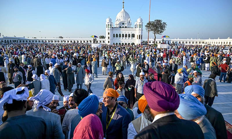 In pictures: Pakistan welcomes scores of Sikh pilgrims to Gurdwara Darbar Sahib in landmark ceremony