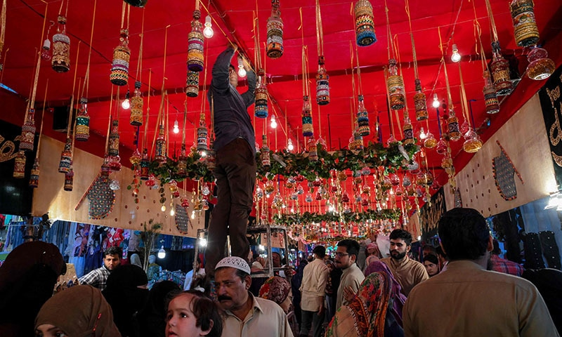A man decorates a street to mark Eid-i-Miladun Nabi in Lahore on November 9. — AFP