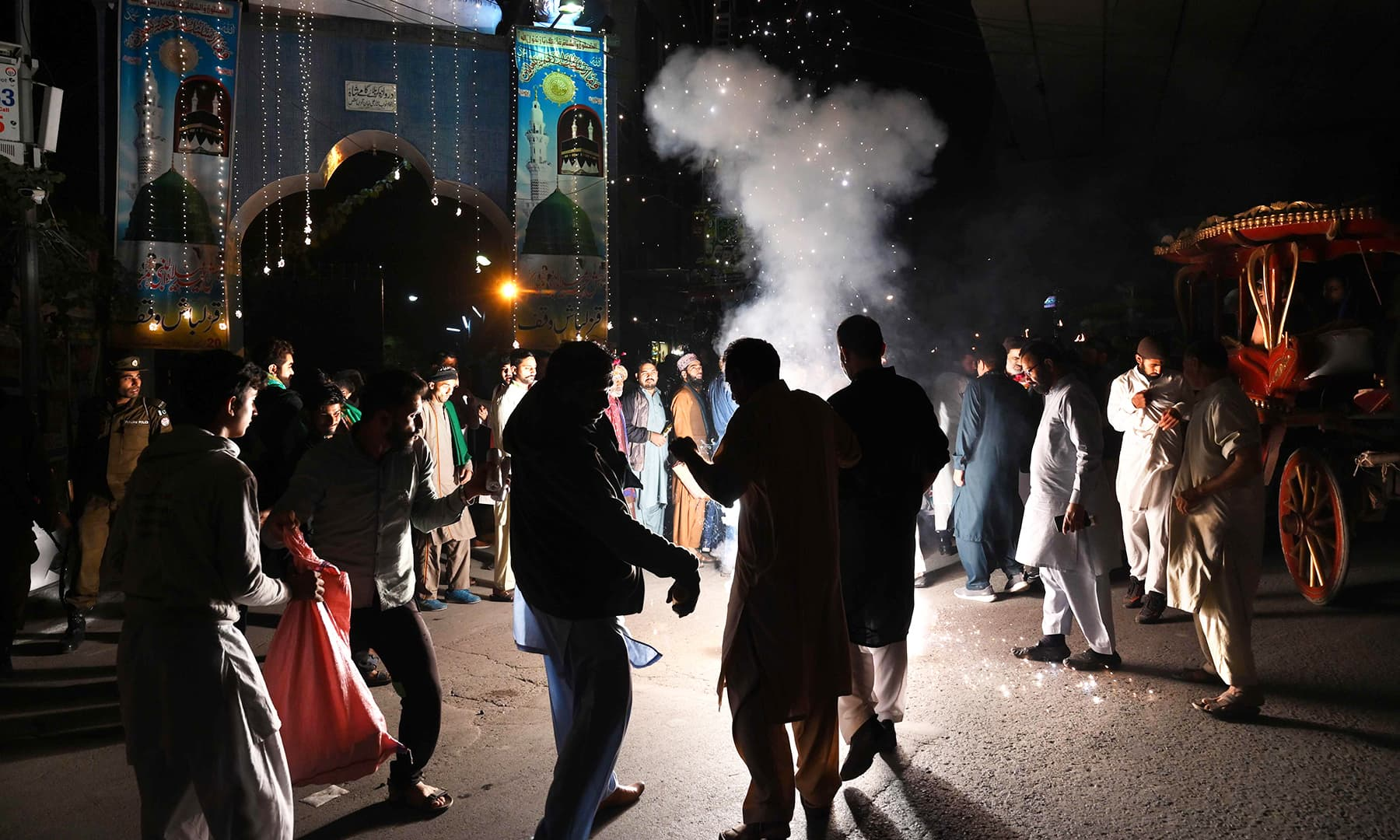 A group of men celebrate with fireworks the eve of Eid-i-Miladun Nabi on Saturday. — AFP