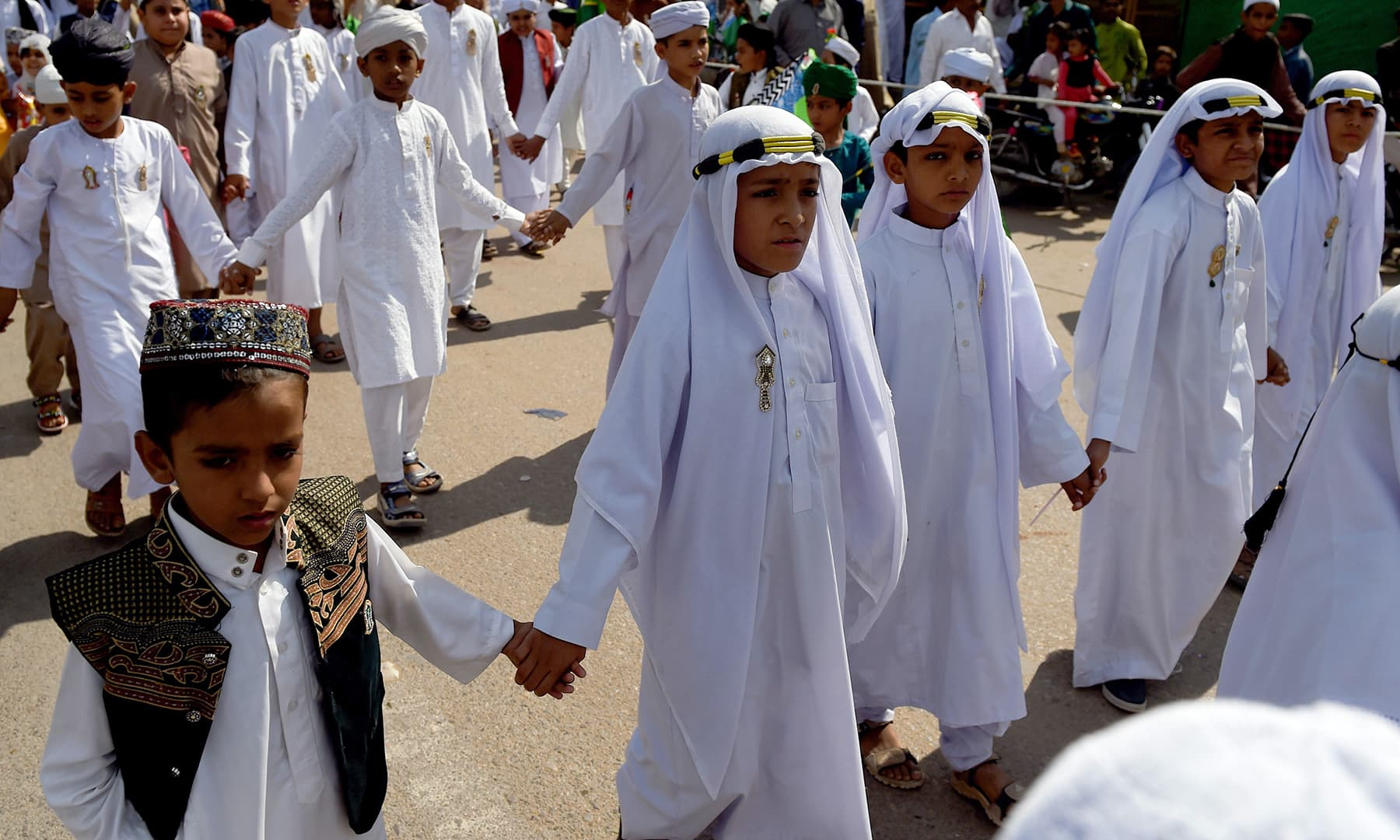 Children in traditional Arabic clothing participate in a procession to mark 12 Rabi-ul-Awwal in Karachi on Sunday. — AFP