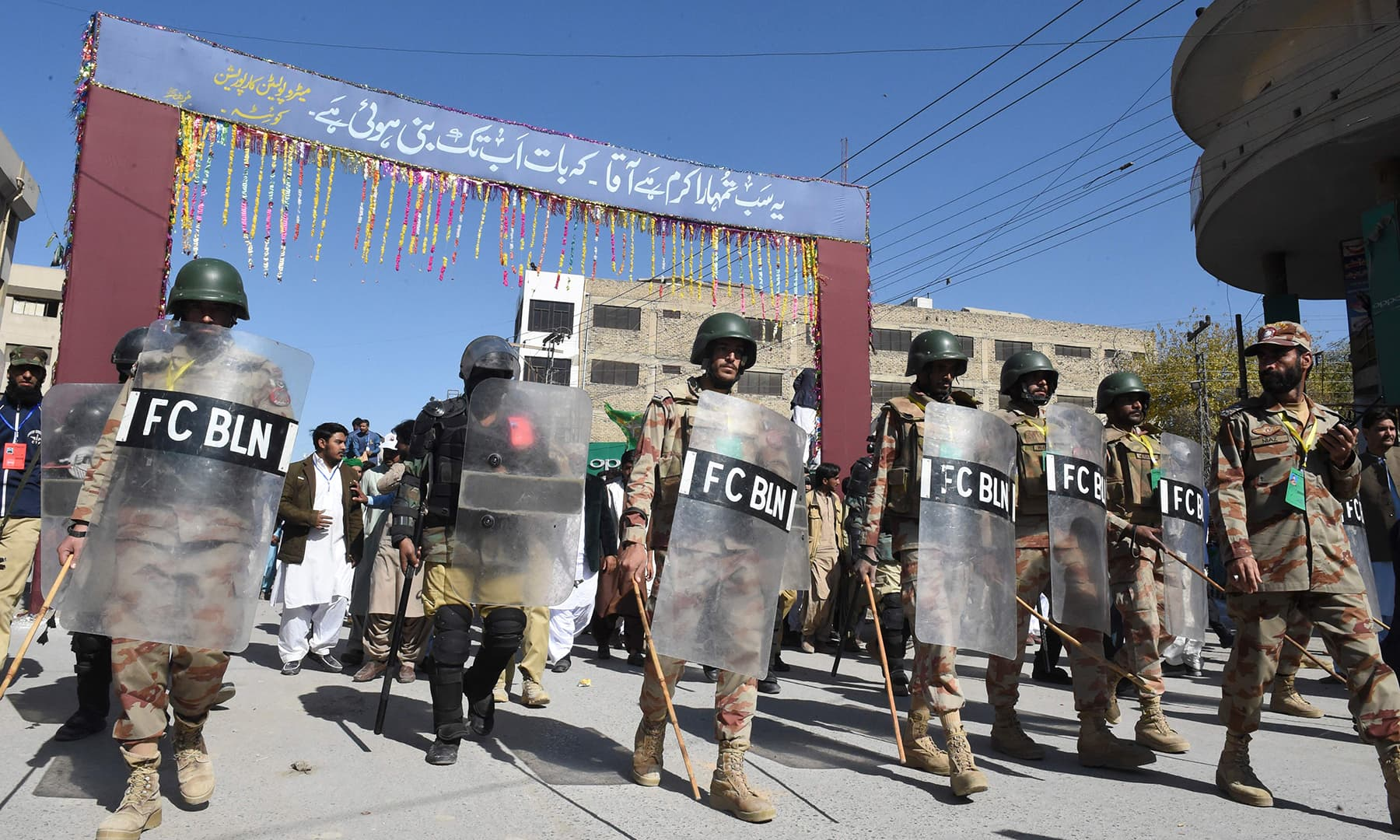 Security personnel lead a procession to celebrate Eid-i-Miladun Nabi, in Quetta on Sunday. — AFP