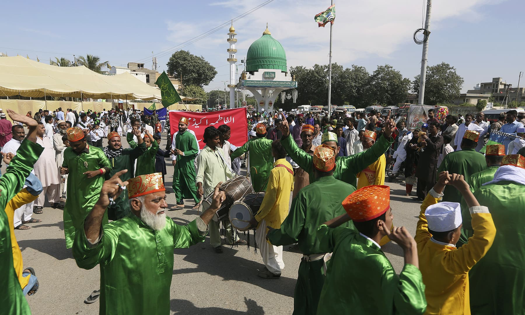 People participate in a rally to celebrate the birth the Holy Prophet (PBUH), in Karachi, on Sunday. — AP
