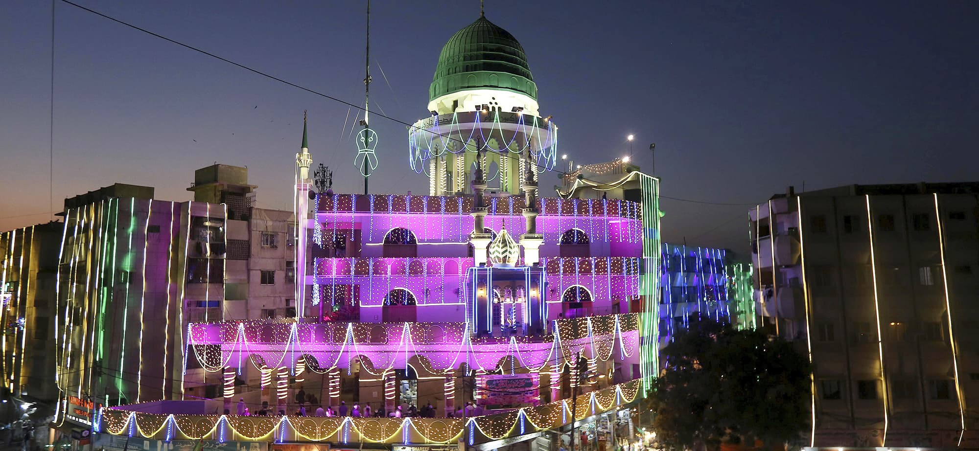 A mosque is decorated with lights for the Mawlid al-Nabi holiday celebrating the birthday of Islam's prophet, Muhammad, born in the year 570, in Karachi, Pakistan, Saturday, Nov. 9, 2019. Thousands of Pakistani Muslims will take part on Sunday in religious processions, ceremonies and distributing free meals among the poor. (AP Photo/Fareed Khan) — Copyright 2019 The Associated Press. All rights reserved.