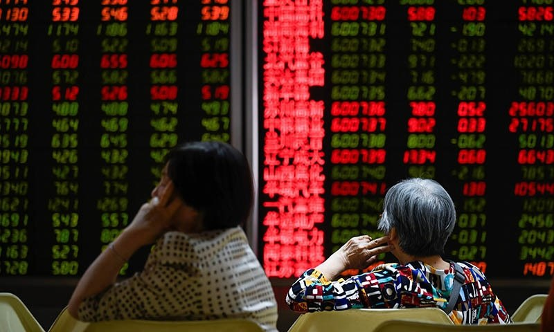 Asian markets turned lower on Monday as another record close on Wall Street was overshadowed by uncertainty over the China-US trade talks, while Hong Kong was also hit by fresh protests in which at least one person was shot. — AFP/File