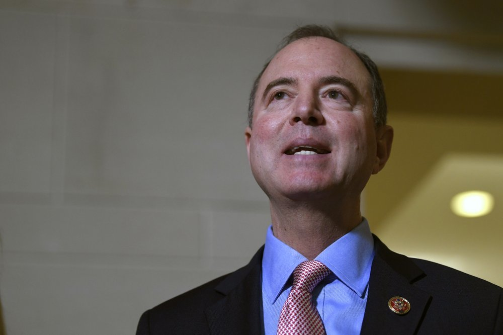 House Intelligence Committee Chairman Adam Schiff talks with reporters on Capitol Hill in Washington on Nov 6 about the House impeachment inquiry. ─ AP