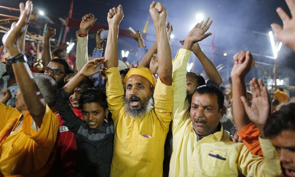 Hindu devotees in Ayodhya celebrate the verdict in a decades-old land title dispute between Muslims and Hindus on Nov 9. — AP/File