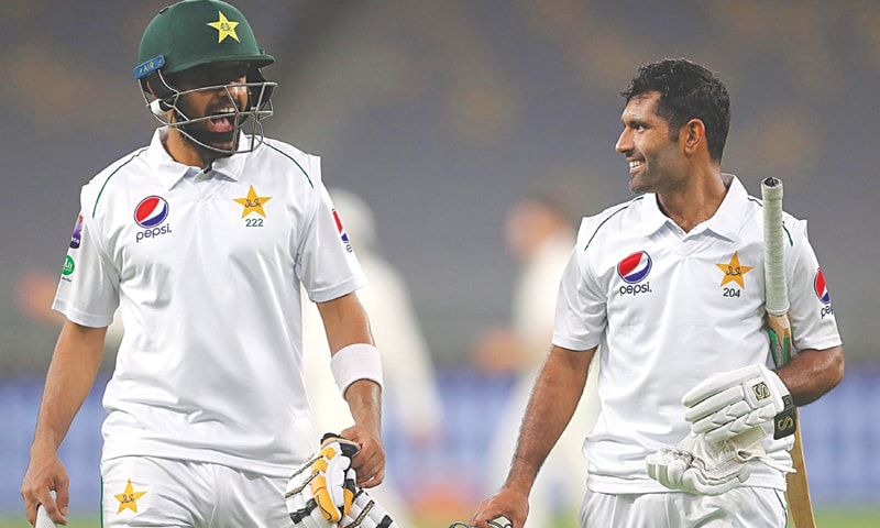 PERTH: Pakistan's centurions Babar Azam (L) and Asad Shafiq look pumped up as they leave the field after the end of play on the first day of the three-day tour match against Australia 'A' at the Perth Stadium.—Courtesy AAP