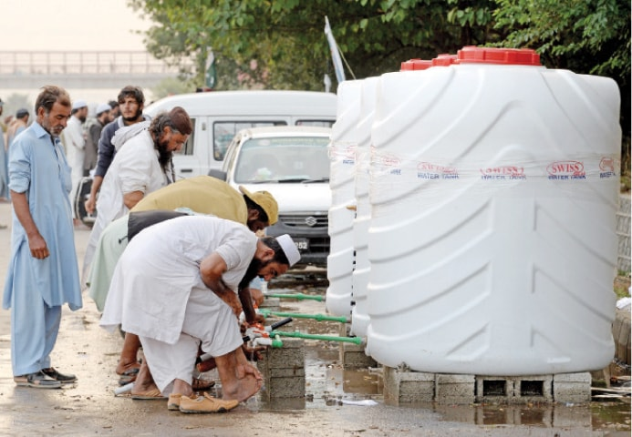 Organisers of the JUI-F sit-in have placed large water tanks for ablution and to meet the rest of the participants' requirements. — Photo by Mohammad Asim