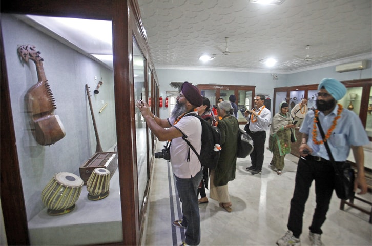 A SIKH visitor takes pictures at the Peshawar Museum on Monday.—Photo by Abdul Majeed Goraya
