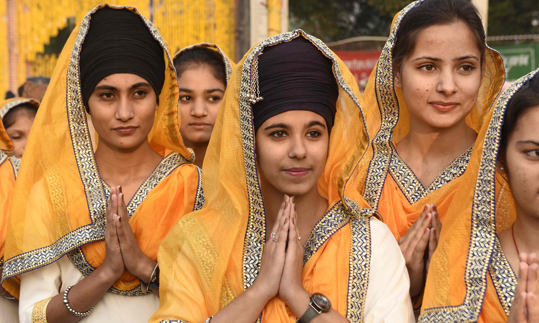 "Sikh students pay respect during a ""Nagar Kirtan"" (holy procession) on the eve of the 550th birth anniversary of Sikhism founder Guru Nanak Dev in Amritsar on November 11. — AFP"