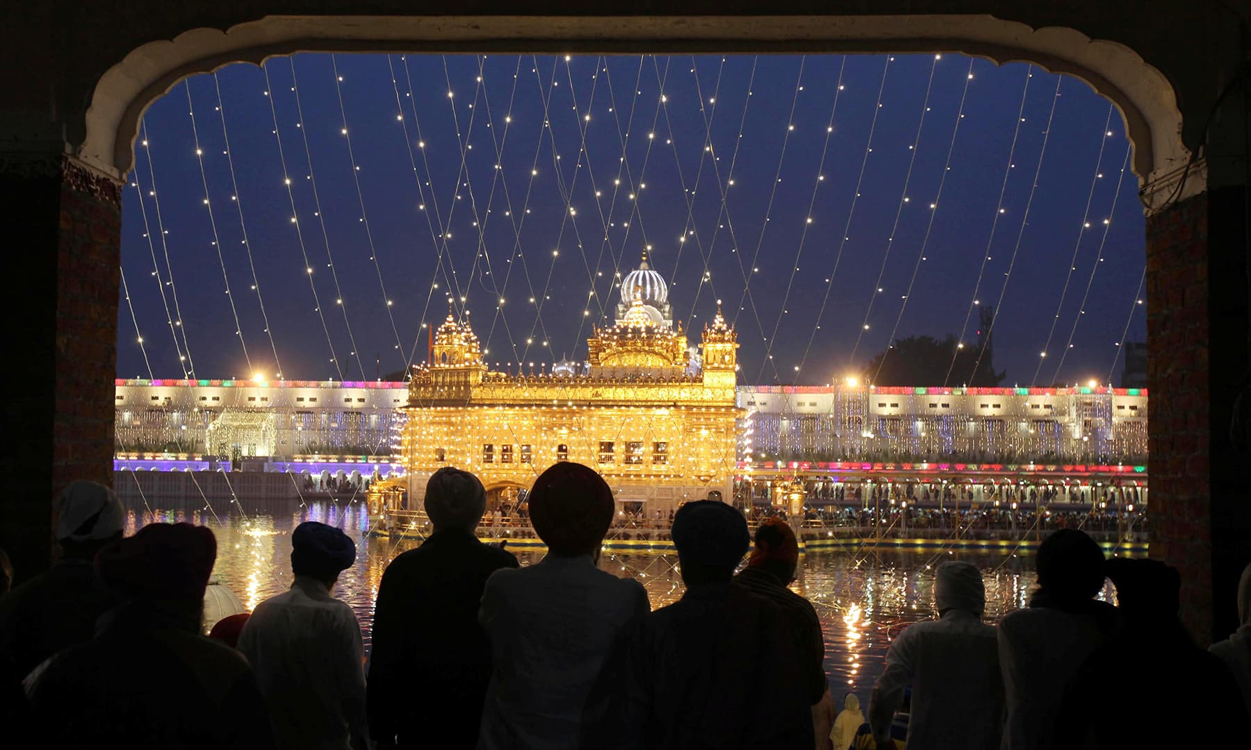 The Golden Temple is seen illuminated as Sikh devotees arrive on the eve of the 550th birth anniversary of Guru Nanak Dev, the first Sikh Guru and founder of Sikh faith, in Amritsar, India on November 11. — Reuters