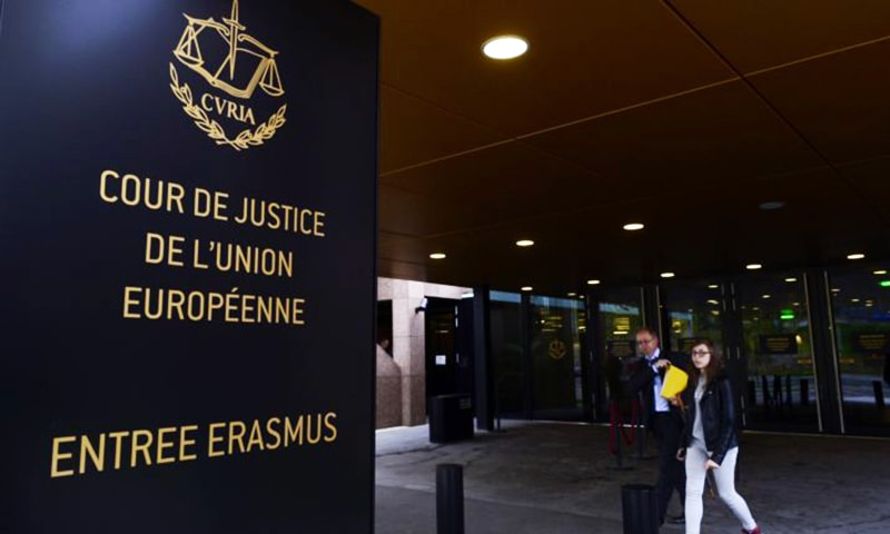 People walk away from the entrance of the European Court of Justice (SCJ) in Luxembourg, on October 5, 2015. —  AFP/File