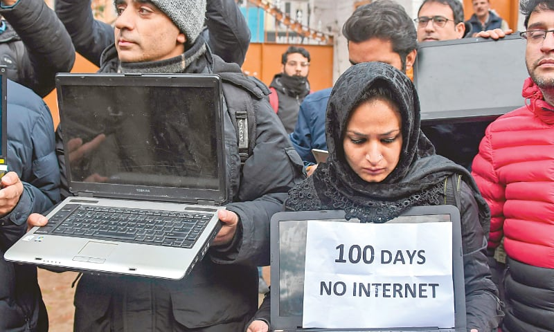 Srinagar: Holding laptops, journalists take part in a protest against continued internet blockade in the occupied region on Tuesday.—AFP