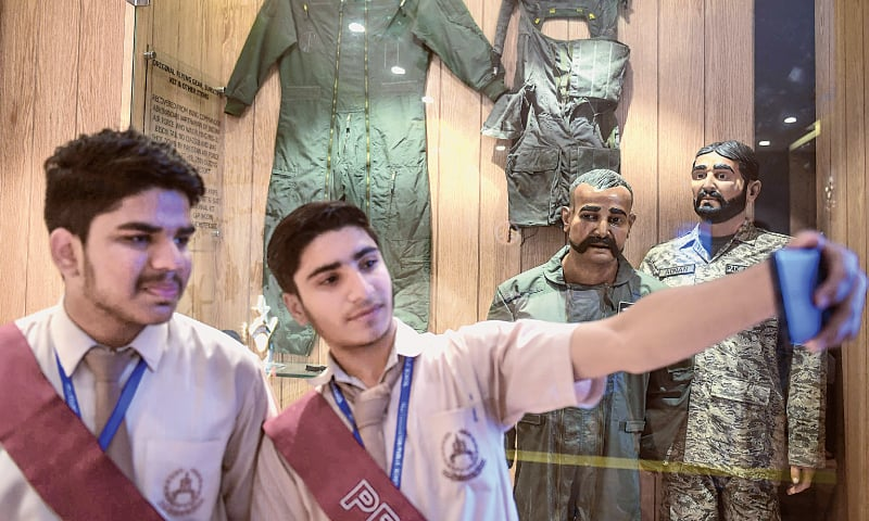Karachi: Students take a selfie in front of the statue of Indian pilot Wing Commander Abhinandan Varthaman, whose plane was shot down earlier this year, at the Pakistan Air Force Museum on Tuesday.—AFP