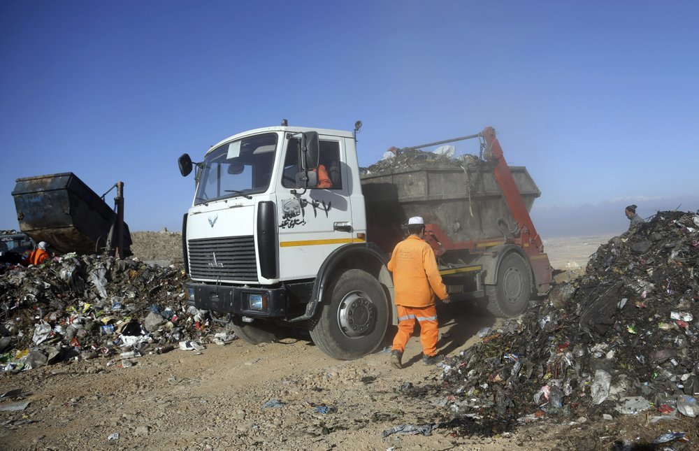 Trucks unload garbage at the Kabul Municipality dump yard, on the outskirts of Kabul, Afghanistan. ─ AP