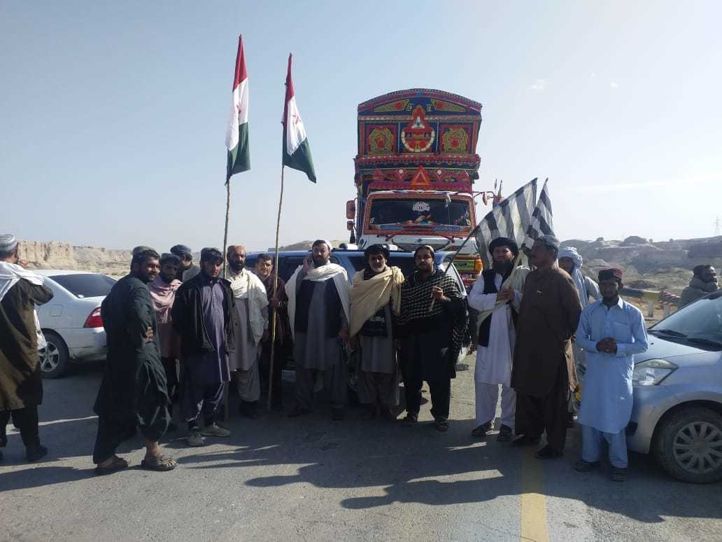 JUI-F and PkMAP workers block a road at the Syed Hameed Cross area. — Photo provided by Syed Ali Shah