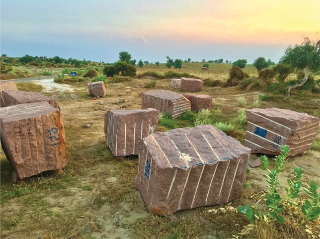 MITHI: Raw granite blocks lie near Karoonjhar hills.—Dawn