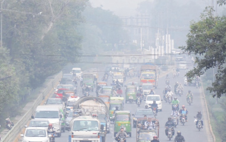A city road engulfed by smog. — Online