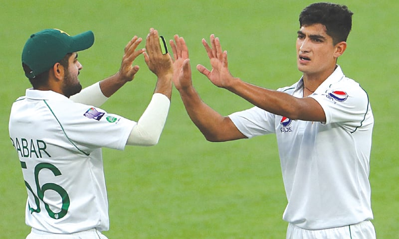 PERTH: Pakistan's young tearaway speedster Nasim Shah celebrates with team-mate Babar Azam after dismissing Australia 'A' opener Marcus Harris during the tour match at the Perth Stadium on Wednesday.—Courtesy AAP