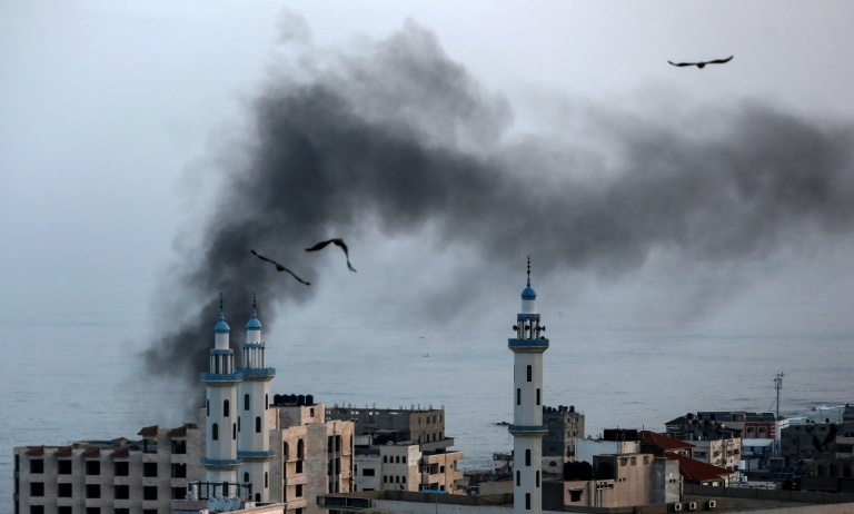 Smoke rises over Gaza City as Israel carries out air and missile strikes. — AFP