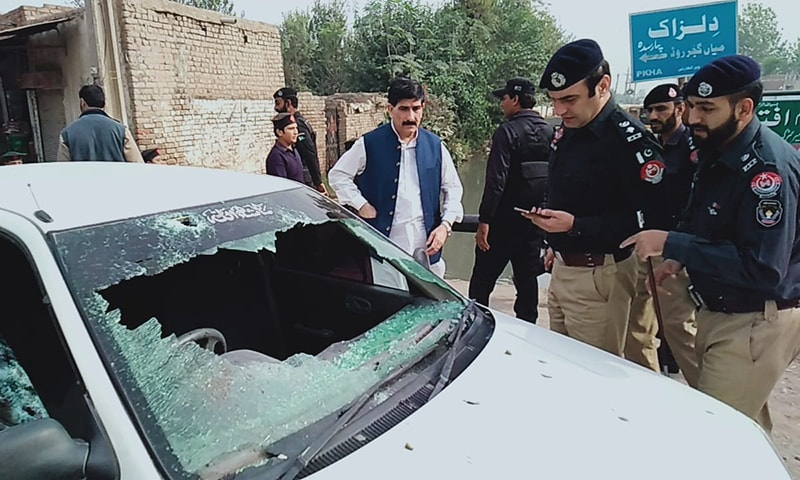Police officers investigate an attack on DSP Ghani Khan's car in Peshawar. — Photo provided by Ali Akbar