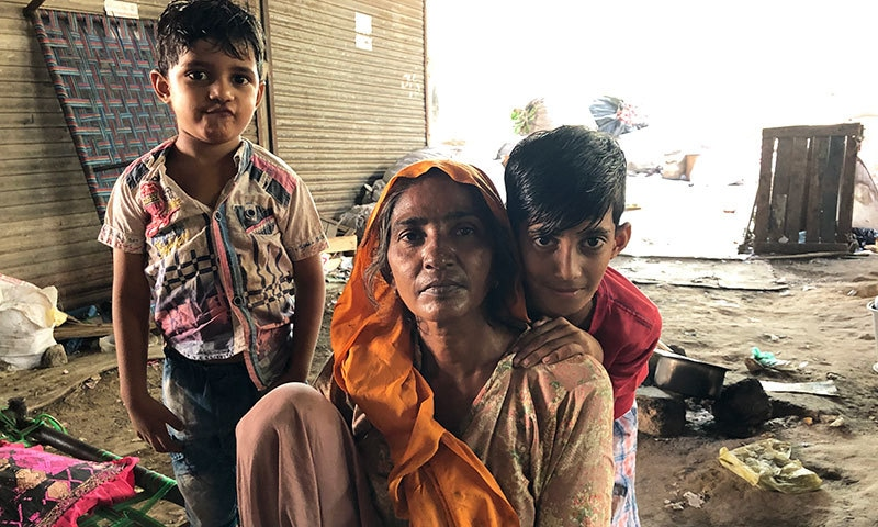 Sahibi with her grandsons. She wants to take them to get vaccinated but does not know where to go. — Photo by writer