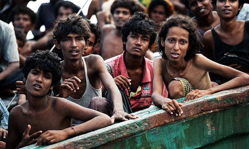 In this file photo taken on May 14, 2015 Rohingya migrants sit on a boat drifting in Thai waters off the southern island of Koh Lipe in the Andaman sea. — AFP/File