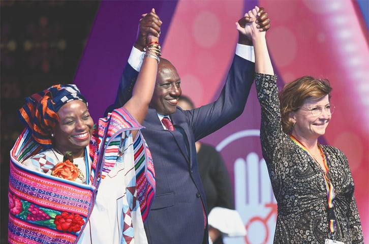Nairobi: Kenya's Deputy President William Ruto (centre) and two delegates hold hands during the closing ceremony of the conference on Thursday. At left is Natalia Kanem, executive director of the United Nations Population Fund, while the other woman is Karen Elleman, a member of the Danish parliament.—AFP
