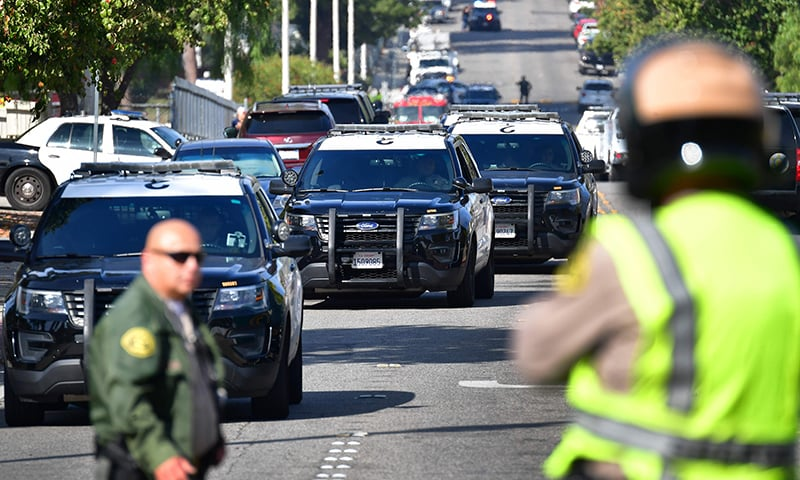 Law enforcement officials are seen outside Saugus High School at Central Park in Santa Clarita, California on November 14. — AFP