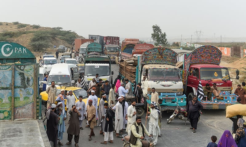 Supporters of  JUI-F block a highway during an anti-government protest in Karachi on November 14, 2019. — AFP