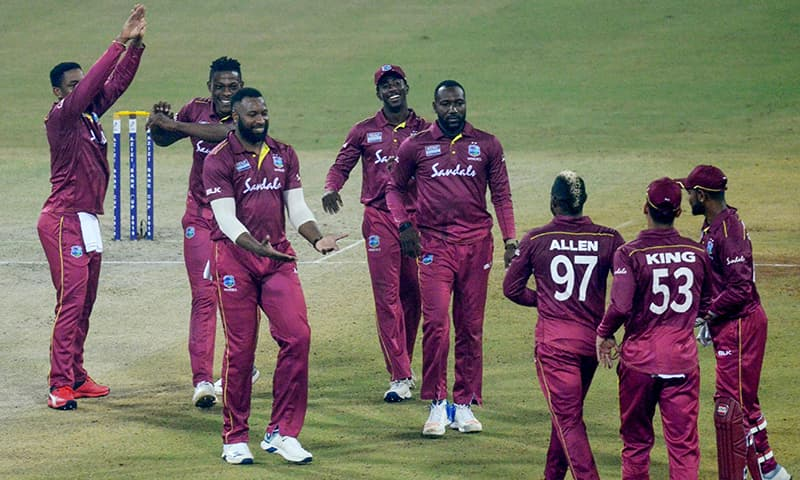West Indies' cricketers celebrate during the first T20 international cricket match of a three-match series between Afghanistan and West Indies at Ekana Cricket Stadium in Lucknow. — AFP